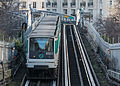 Paris Metro Line 6 train northeast of Pasteur station 140207 5.jpg