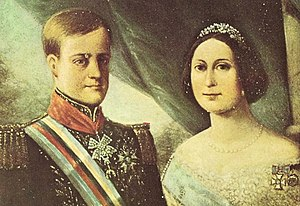 A side-by-side portrait with a light-haired, clean-shaven young man in a military-style tunic on the left, and on the right, a young woman with dark hair decorated with a tiara