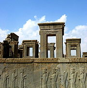 The ruins of Persepolis known as the Takht-e Jamshid or throne of Jamshid is part of the ancient architectural tradition of Persia.
