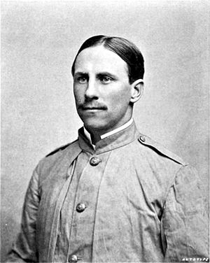 Black and white photograph of a man in a coat.