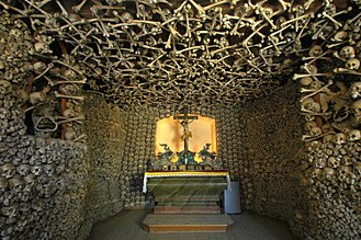 The Skull Chapel in Kudowa-Zdroj, Lower Silesian Voivodeship, Poland, is an example of an attraction for dark tourism. Its interior walls, ceiling and foundations are adorned by human remains. It is the only such monument in Poland, and one of six in Europe. Poland - Czermna - Chapel of Skulls - interior 06.jpg