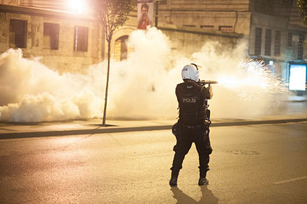 Police officer firing tear gas. Istanbul, 15/16 June Police action during Gezi park protests in Istanbul. Events of June 16, 2013-6.jpg