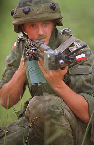Multiple integrated laser engagement system - Polish Soldier with MILES gear, AKMS and three magazines taped together jungle style.