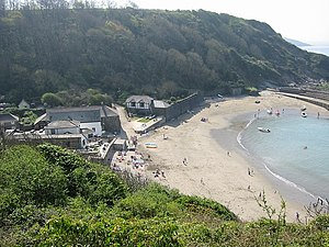 Fowey Lifeboat Station - Polkerris. The old lifeboat house is the large white building on the left.