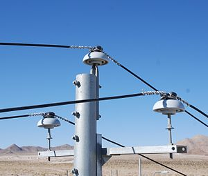 Insulator (electricity) - Power lines with ceramic insulators in California, USA