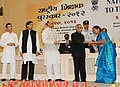 Pranab Mukherjee presenting the National Award for Teachers-2012 to Smt. Usha Dwivedi, New Delhi, on the occasion of the 'Teachers Day', in New Delhi. The Union Minister for Human Resource Development.jpg