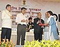 Pranab Mukherjee presenting the Rajat Kamal Special Jury Award (shared) Cancer Katha (English) in Non Feature Film Section to the Director, Ms. Vasudha Joshi, at the 60th National Film Awards function.jpg
