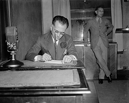 Manuel Quezon signing documents. President Manuel Quezon of Philippine Commonwealth broadcast from Washington today to his fellow-countrymen in Manila.jpg