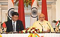 Prime Minister Shri Narendra Modi at the Press Briefing with President Xi Jinping of China.jpg