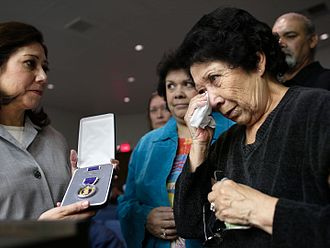 Hilda Solis - Congresswoman Solis presents a posthumous Purple Heart to the widow of a World War II veteran in El Monte, California, in 2004.