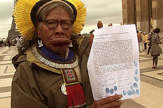 Belo Monte Dam - Chief Raoni in Paris with his petition against Belo Monte Dam.