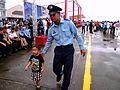 ROCAF Staff Sergeant Leading Boy Go Back Visitors Area 20120811.jpg