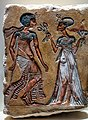 Relief of a young pharaoh and a queen holding flowers 01.jpg