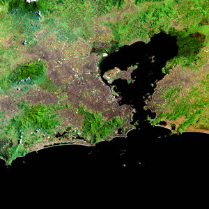 Greater Rio de Janeiro - Satellite image of the metropolitan area, with the capital from the center below, Baixada Fluminense on the north-west and Niterói and São Gonçalo east of the Guanabara Bay
