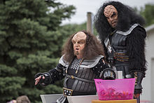 Photograph of two people in Klingon costume