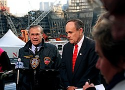 Donald Rumsfeld and Rudy Giuliani at the site of the World Trade Center, on November 14, 2001.