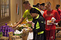 Runners receive breakfast after completing the Marine Corps Community Services St. Patrick's Day 5K Fun Run aboard Marine Corps Air Station Beaufort, S.C., March 13, 2014 140314-M-VR358-056.jpg