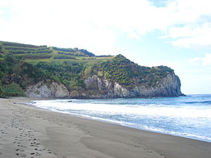 Porto Formoso - The beach and cliffs of the Praia dos Moinhos, one of the few white-sand beaches on the island of São Miguel