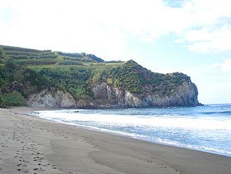 Porto Formoso - The beach and cliffs of the Praia dos Moinhos, one of the few white-sand beaches on the island of São Miguel