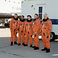 STS-31 crew poses on EAFB concrete runway after egressing Discovery.jpg