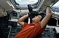 STS-41 Pilot Cabana points ROLLEI camera out aft flight deck overhead window.jpg