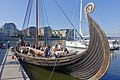 Saga Oseberg viking ship replica Tønsberg Norway Young students oars mooring Byfjorden Harbour havn Brygga pier board walk dock Fore Bow stempost Framstavn Kaldnes Apartements 2019-08-26 blurred faces 5172.jpg