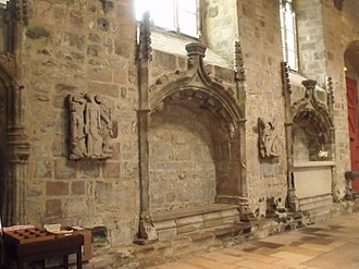 """Saint-Brieuc Cathedral - A view along the nave of Saint Etienne cathedral in Saint-Brieuc. Note the enfeu or walled tombs and two of Saupique's """"stations of the Cross"""""""