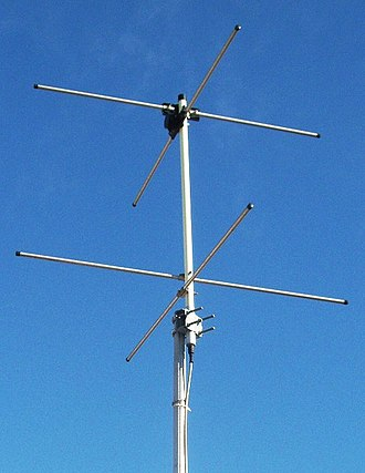 Turnstile antenna - An axial-mode turnstile antenna for 136-137 MHz to receive data from weather satellites, consisting of a pair of driven crossed dipoles above a pair passive crossed dipoles serving as a reflector.