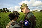 Senior Airman Chance Sheek teaches compass use to CAP cadet in Japan.JPG