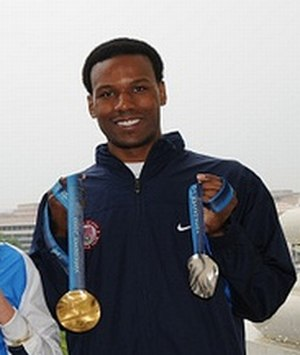 Shani Davis - Shani Davis with medals won in the 2010 Olympics