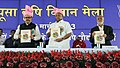 Sharad Pawar releasing a book at the Pusa Krishi Vigyan Mela-2013, in New Delhi on March 06, 2013. The Minister of State for Agriculture & Food Processing Industries, Shri Tariq Anwar is also seen.jpg