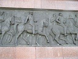Guillermo I de Alemania (izquierda) y Otto von Bismarck representados en la parte baja de la columna.