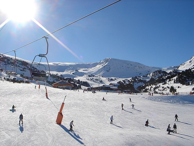Ski slope in Andorra with skiers