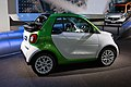 Side view of white and green Fortwo Cabrio Electric Drive at IAA 2017 in Frankfurt.