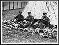 Sorting out helmets and gas masks taken from German prisoners (4688023005).jpg
