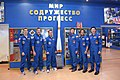 Soyuz TMA-22 prime and backup crews around a model of a Soyuz rocket.jpg