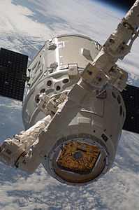 SpaceX Dragon C2+ during ISS grapple ops (ISS031-E-071199).jpg