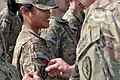 Spc. Mary Cris Waing receives her combat patch.jpg