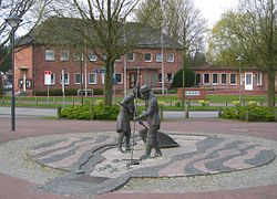 The town hall with a sculpture Jan und Gret symbolising the hard work of coastal fishermen before the onset of tourism[1]