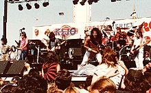Jefferson Starship onstage at Great America, June 23, 1984, shortly before they became Starship (l-to-r Grace Slick, Mickey Thomas, Pete Sears, Paul Kantner, Craig Chaquico, Donny Baldwin, and David Freiberg)