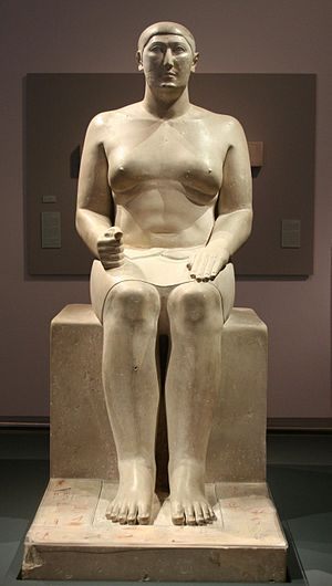 Hemiunu - Statue of Hemiunu at the Pelizaeus Museum, Hildesheim, Germany. His feet rest on columns of hieroglyphs, painted in yellow, red, brown, and black.