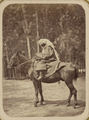 Street Types of Central Asian Cities. A Mazang Woman Astride a Horse WDL11124.png