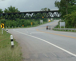 The railway bridge of northeastern rail route crosses over Suranarai Road in Thep Sathit