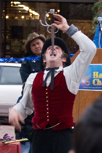Sword swallowing - Individual performing sword swallowing feat
