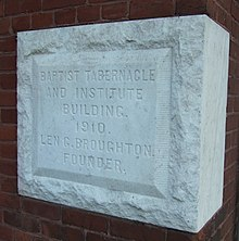 "A white stone block inscribed with ""BAPTIST TABERNACLE AND INSTITUTE BUILDING. 1910. LEN G. BROUGHTON, FOUNDER."""