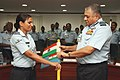 The Chief of the Air Staff, Air Chief Marshal P.V. Naik handing over the ice axes with Indian and IAF flags to team leader Squadron Leader Nirupama Pandey, leading the IAF expedition to Mount Kamet, in a flag off ceremony.jpg