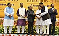 The President, Shri Pranab Mukherjee presenting the National Award for Teachers-2015 to Shri Bollepalli Madhusudana Raju (Telangana), on the occasion of the 'Teachers Day', in New Delhi.jpg