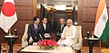 The Prime Minister, Shri Narendra Modi and the Prime Minister of Japan, Mr. Shinzo Abe in a one-on-one meeting before the start of India-Japan Business Leaders Forum, in New Delhi on December 12, 2015 (1).jpg