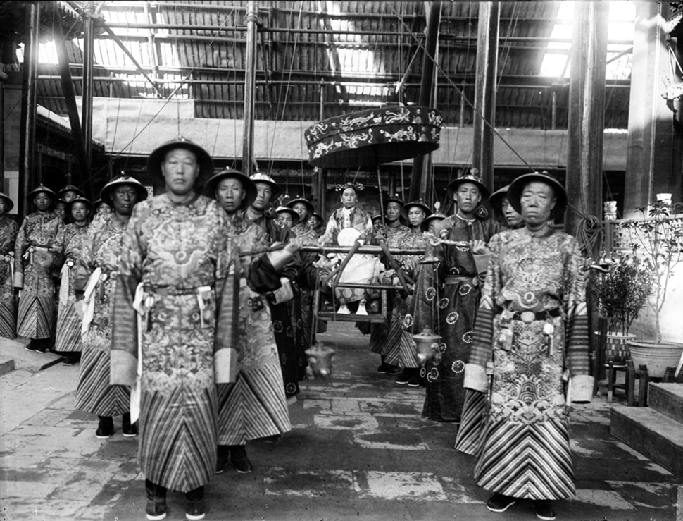 The Qing Dynasty Cixi Imperial Dowager Empress of China On Throne Sedan With Palace Enuches.PNG