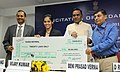 The Union Steel Minister, Shri Beni Prasad Verma presenting the cheque of Rs. 20 Lakh to Ms. Saina Nehwal, the London Olympic Bronze Medal winner in Badminton, at a felicitation function, in New Delhi on August 16, 2012.jpg